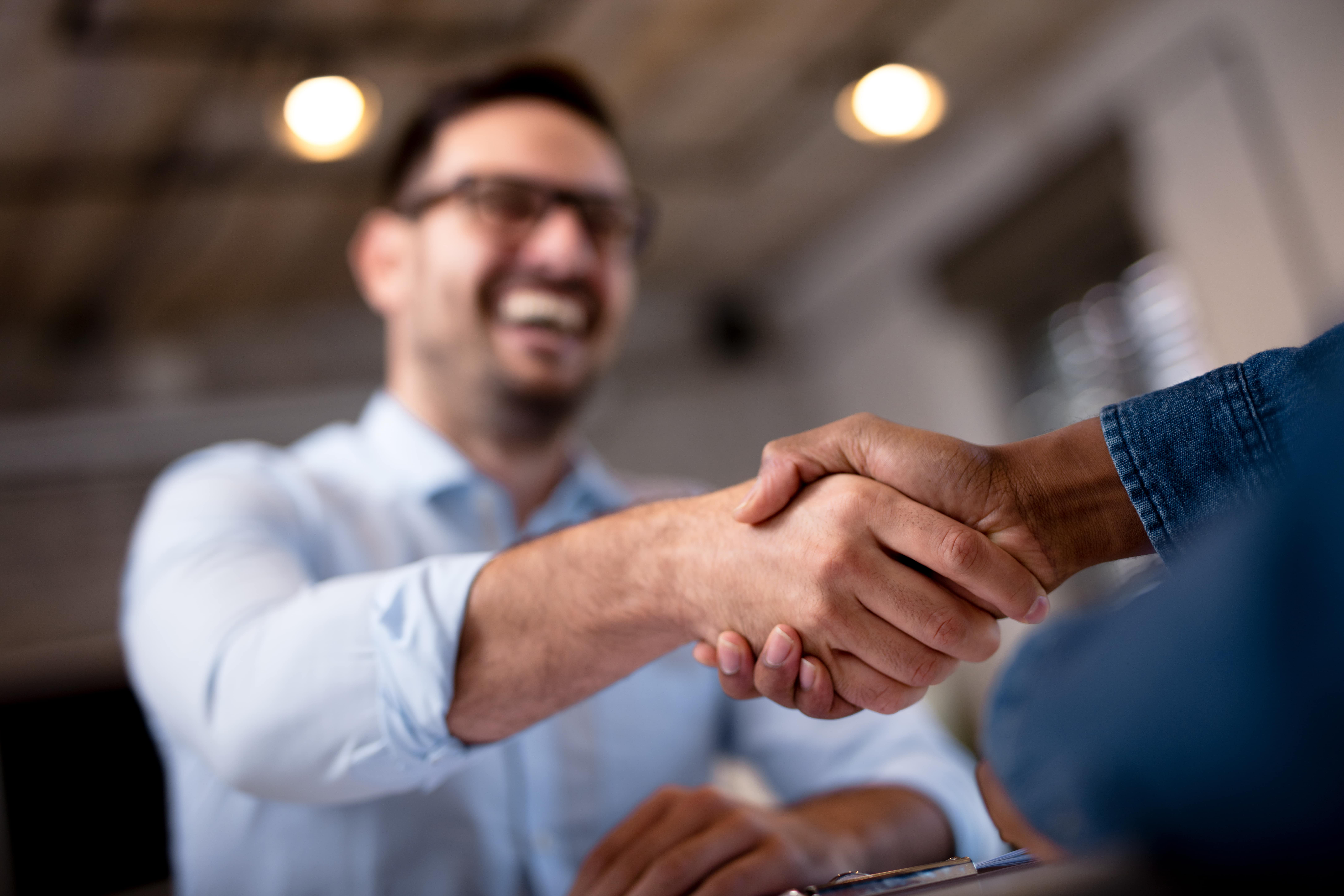 Business People Shaking Hands 600w 719542471