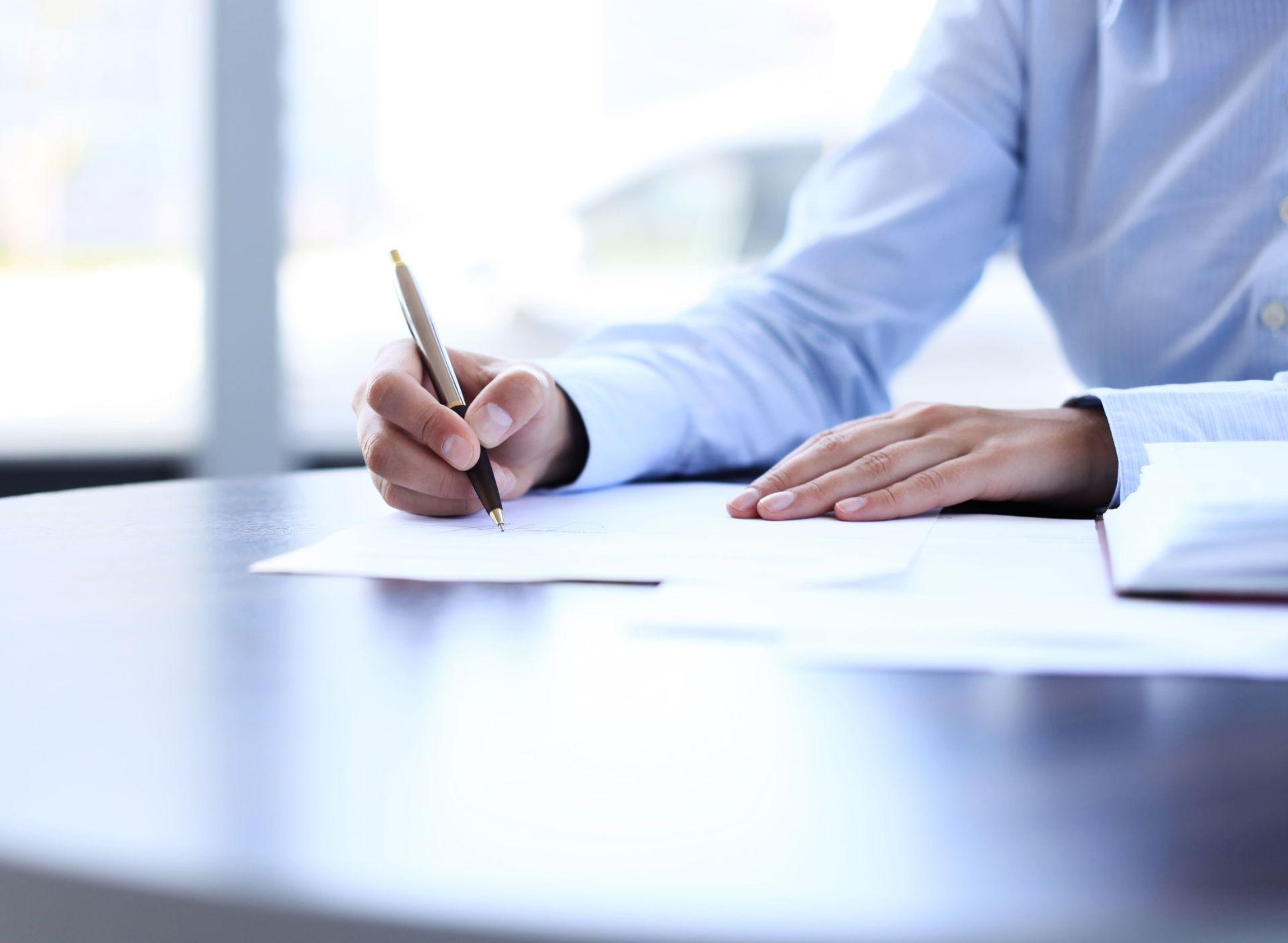 Businesswoman Sitting Office Desk Signing 600w 203485126